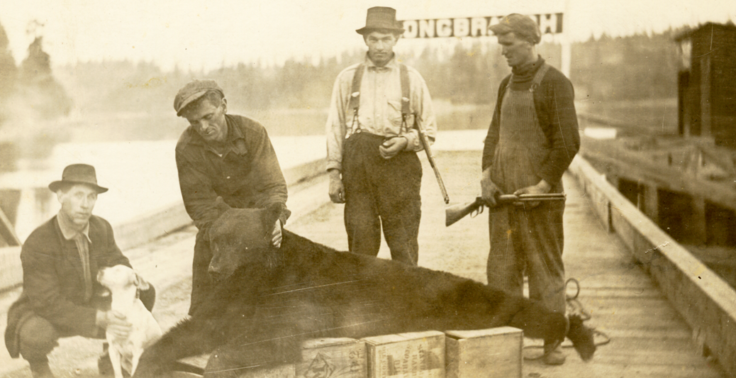 Rickart brothers on Longbranch Dock with bear